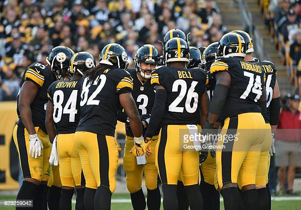 Quarterback Landry Jones of the Pittsburgh Steelers huddles with the offense, including tight end Xavier Grimble, wide receiver Antonio Brown, tight...