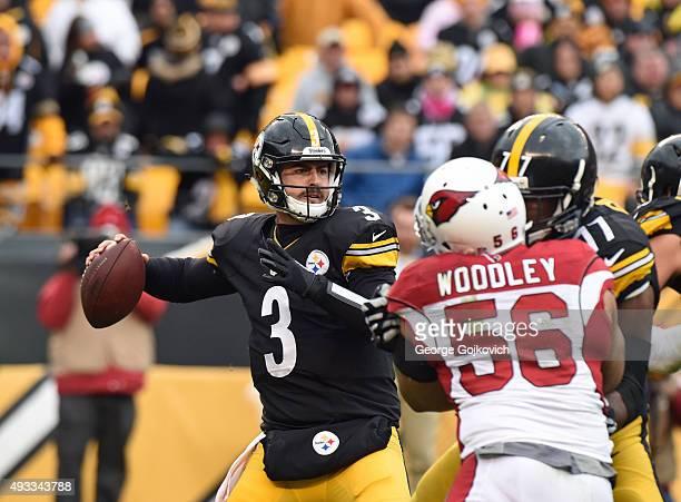 Quarterback Landry Jones of the Pittsburgh Steelers passes as offensive lineman Marcus Gilbert blocks linebacker LaMarr Woodley of the Arizona...