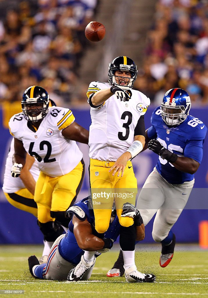 Quarterback Landry Jones #3 of the Pittsburgh Steelers throws the ball under pressure against the Pittsburgh Steelers during a preseason game at MetLife Stadium on August 9, 2014 in East Rutherford, New Jersey.