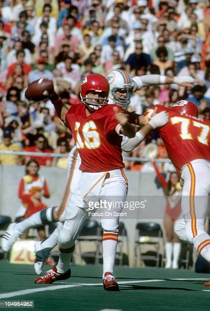 Quarterback Len Dawson of the Kansas City Chiefs drops back to pass against the Miami Dolphins during an NFL football game circa 1973 at Arrowhead...