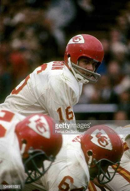 Quarterback Len Dawson of the Kansas City Chiefs get under center at the line of scrimmage during an NFL football game Dawson played for the Chiefs...