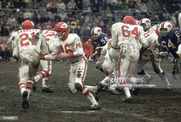 Quarterback Len Dawson of the Kansas City Chiefs hands the ball off to Mike Garrett of the Kansas City Chiefs during the AFC Championship Game...