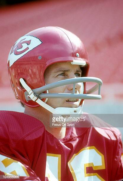 Quarterback Len Dawson of the Kansas City Chiefs looks on from the sidelines during an NFL football game circa 1974 at Arrowhead Stadium in Kansas...