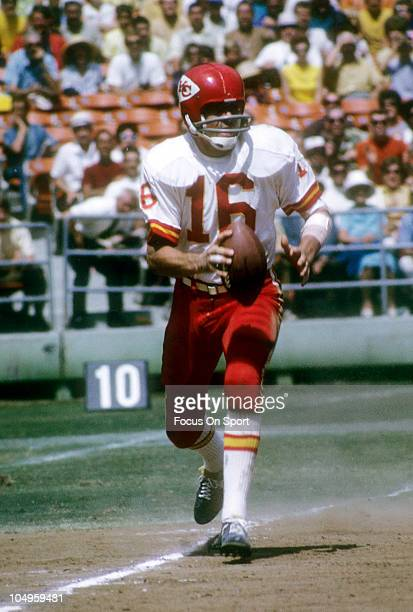 Quarterback Len Dawson of the Kansas City Chiefs rolls out to pass against the San Diego Chargers during an NFL football game circa 1970 at Jack...