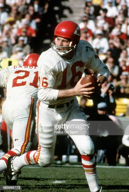 Quarterback Len Dawson of the Kansas City Chiefs rolls out to pass against the Green Bay Packers during Super Bowl I January 15 1967 at the Los...
