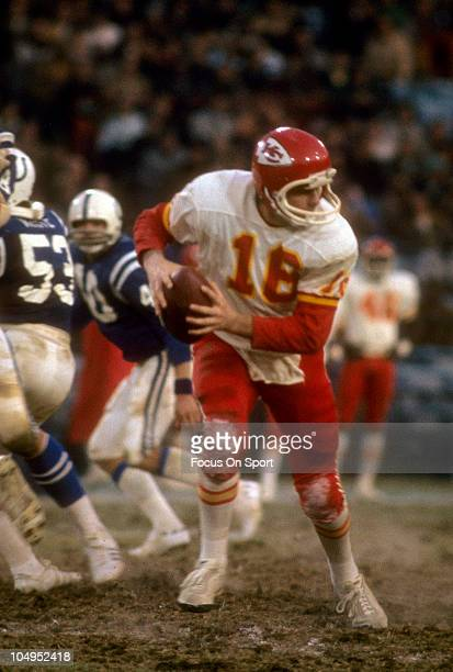 Quarterback Len Dawson of the Kansas City Chiefs runs with the ball against the Baltimore Colts during an NFL football game November 30 1975 at...