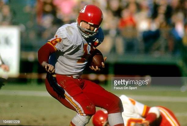 Quarterback Len Dawson of the Kansas City Chiefs scrambles with the ball against the Atlanta Falcons during an NFL football game December 17 1972 at...