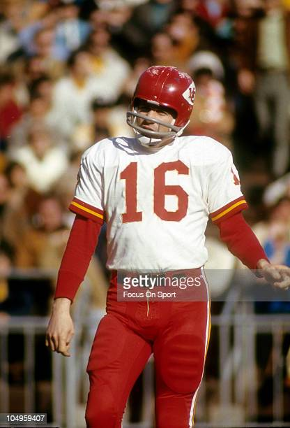 Quarterback Len Dawson of the Kansas City Chiefs standing on the field against the Oakland Raiders during an NFL football game circa 1970 at the...