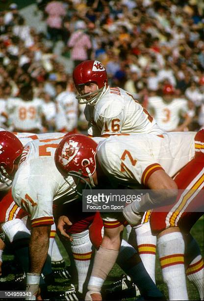 Quarterback Len Dawson of the Kansas City Chiefs stands under center at the line of scrimmage against the Oakland Raiders during an NFL football game...