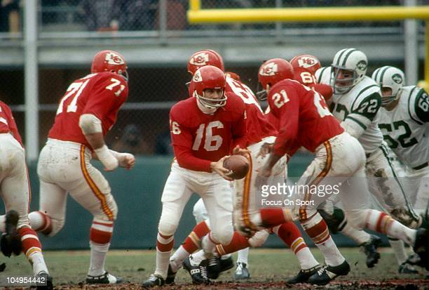 Quarterback Len Dawson of the Kansas City Chiefs turns to hand the ball off to running back Mike Garrett against the New York Jets during an NFL...