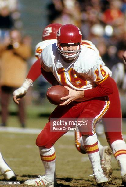 Quarterback Len Dawson of the Kansas City Chiefs turns to hand the ball off to a running back against the Atlanta Falcons during an NFL football game...