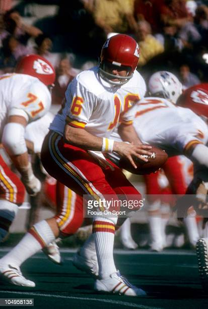Quarterback Len Dawson of the Kansas City Chiefs turns to hand the ball off to a running back against the New England Patriots during an NFL football...