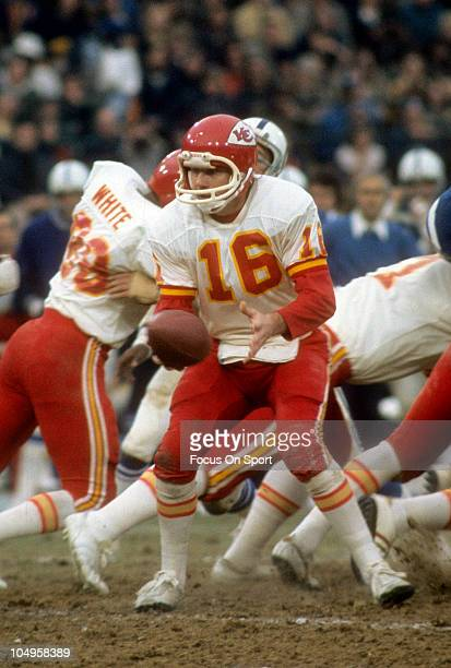 Quarterback Len Dawson of the Kansas City Chiefs turns to hand the ball off to a running back against the Baltimore Colts during an NFL football game...