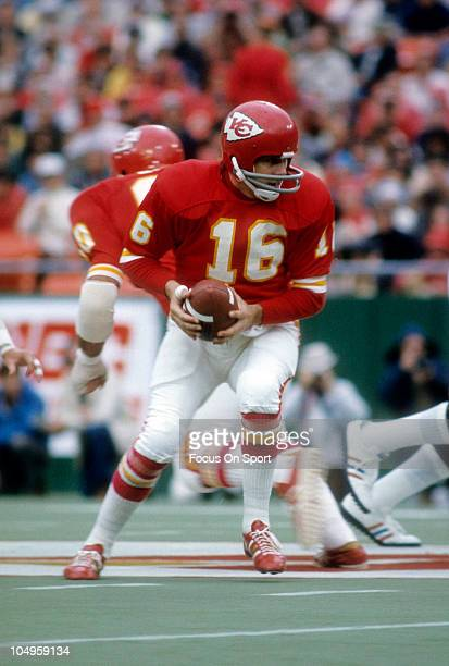 Quarterback Len Dawson of the Kansas City Chiefs turns to hand the ball off to a running back during an NFL football game circa 1973 at Arrowhead...