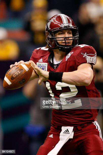 Quarterback Levi Brown of the Troy Trojans looks to throw a pass against the Southern Mississippi Golden Eagles in the RL Carriers New Orleans Bowl...