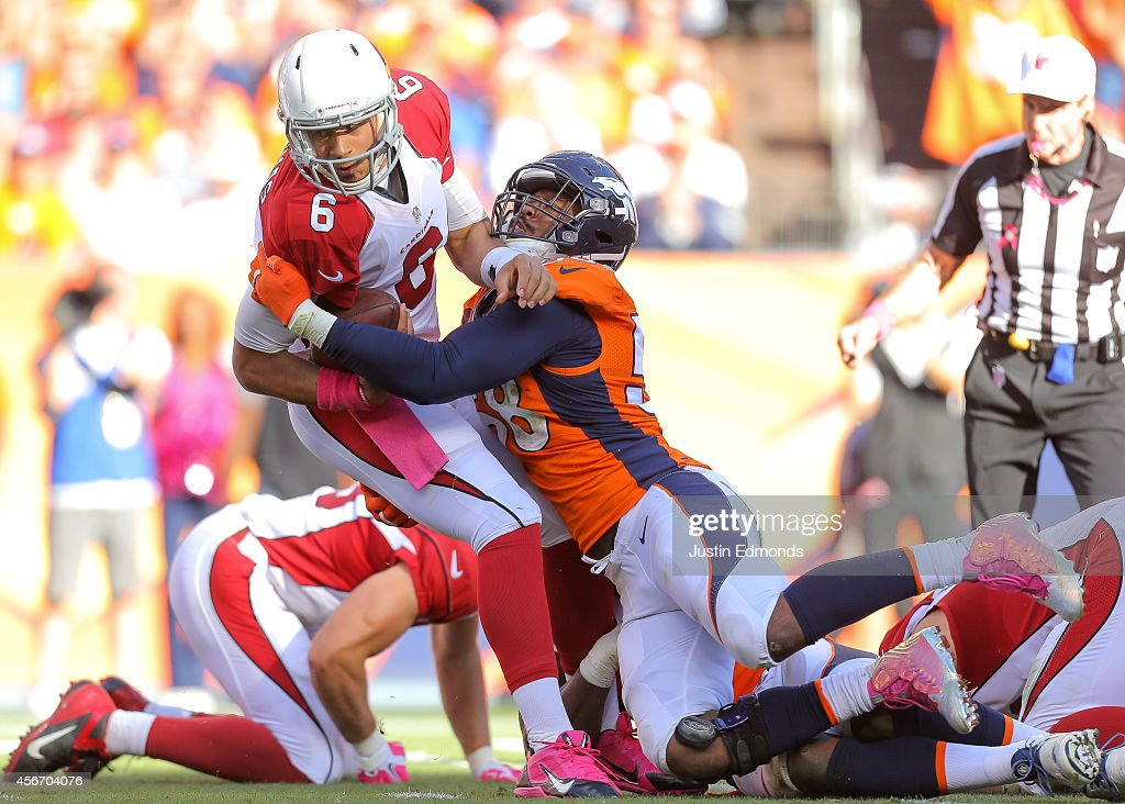 Quarterback Logan Thomas #6 of the Arizona Cardinals is sacked by outside linebacker Von Miller #58 of the Denver Broncos during a game at Sports Authority Field at Mile High on October 5, 2014 in Denver, Colorado.