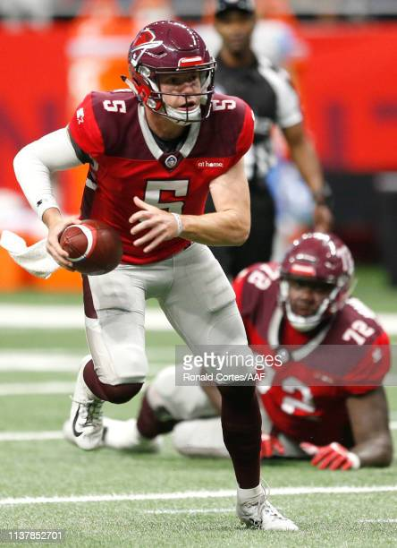 Quarterback Logan Woodside of San Antonio Commanders scrambles with the ball during the second quarter of the Alliance of American Football game...