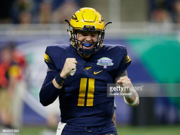 Quarterback Logan Woodside of the Toledo Rockets celebrates a touchdown against Akron during the first half at Ford Field on December 2, 2017 in...