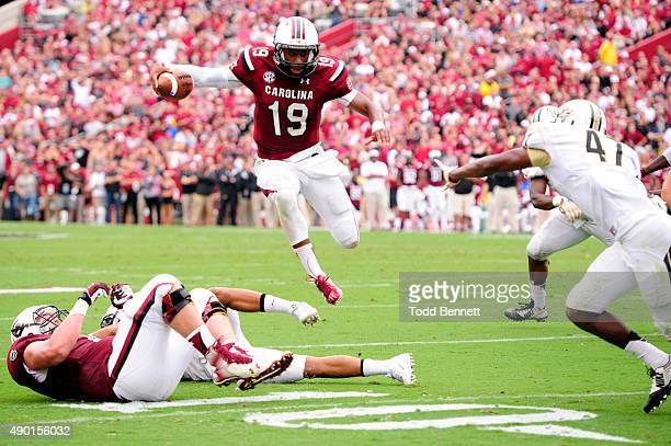 Quarterback Lorenzo Nunez of the South Carolina Gamecocks goes airborne to avoid defenders from the University of Central Florida Knights during the...