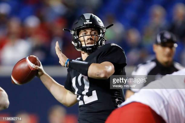 Quarterback Luis Perez  #12 of the Birmingham Iron throws a pass the Memphis Express during the first quarter of their Alliance of American Football...