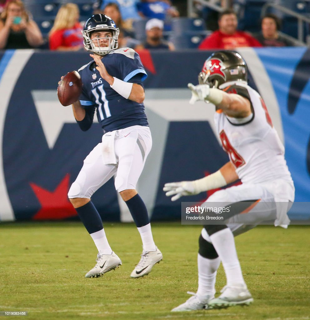 Quarterback Luke Falk #11 of the Tennessee Titans drops back to pass against the Tampa Bay Buccaneers during the second half of a pre-season game at Nissan Stadium on August 18, 2018 in Nashville, Tennessee.
