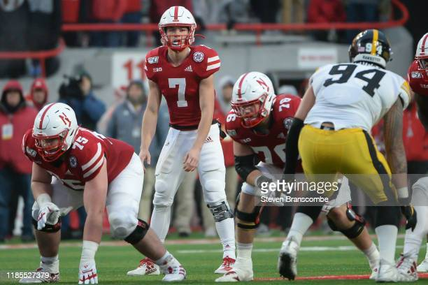 Quarterback Luke McCaffrey of the Nebraska Cornhuskers looks over the line against the Iowa Hawkeyes at Memorial Stadium on November 29, 2019 in...