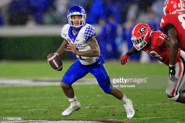 Quarterback Lynn Bowden Jr of the Kentucky Wildcats scrambles out of the pocket during the SEC football game between the Georgia Bulldogs and the...