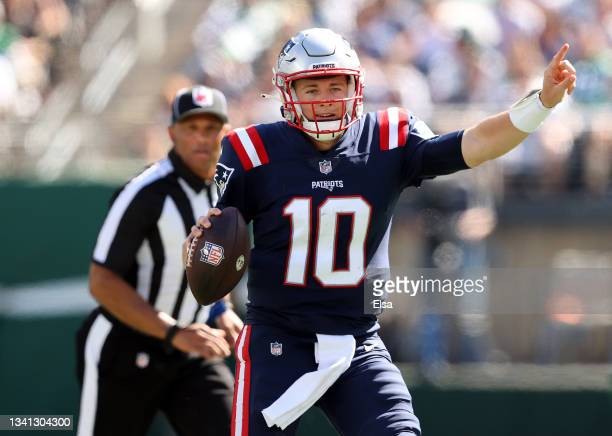 Quarterback Mac Jones of the New England Patriots directs the offense on the move against the New York Jets in the first half of the game at MetLife...