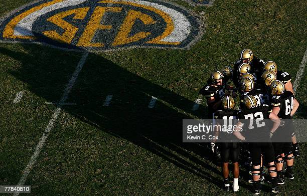 Quarterback Mackenzi Adams of the Vanderbilt Commodores calls the offensive play in the huddle against the Kentucky Wildcats during the second half...