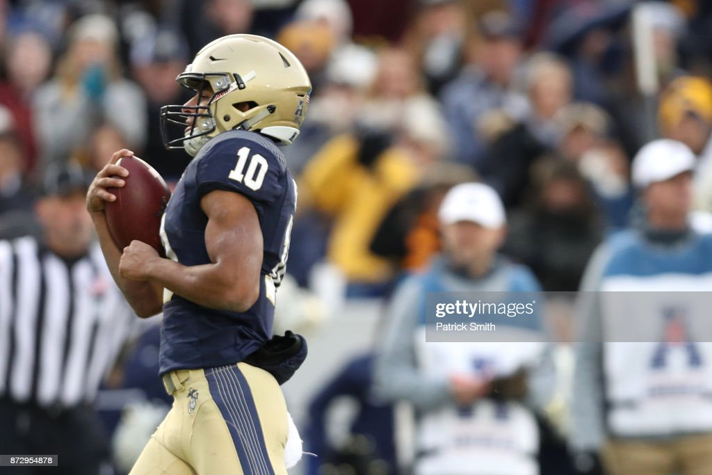 Quarterback Malcolm Perry #10 of the Navy Midshipmen scores a touchdown during the first quarter against the Southern Methodist Mustangs during the first half at Navy-Marines Memorial Stadium on November 11, 2017 in Annapolis, Maryland.