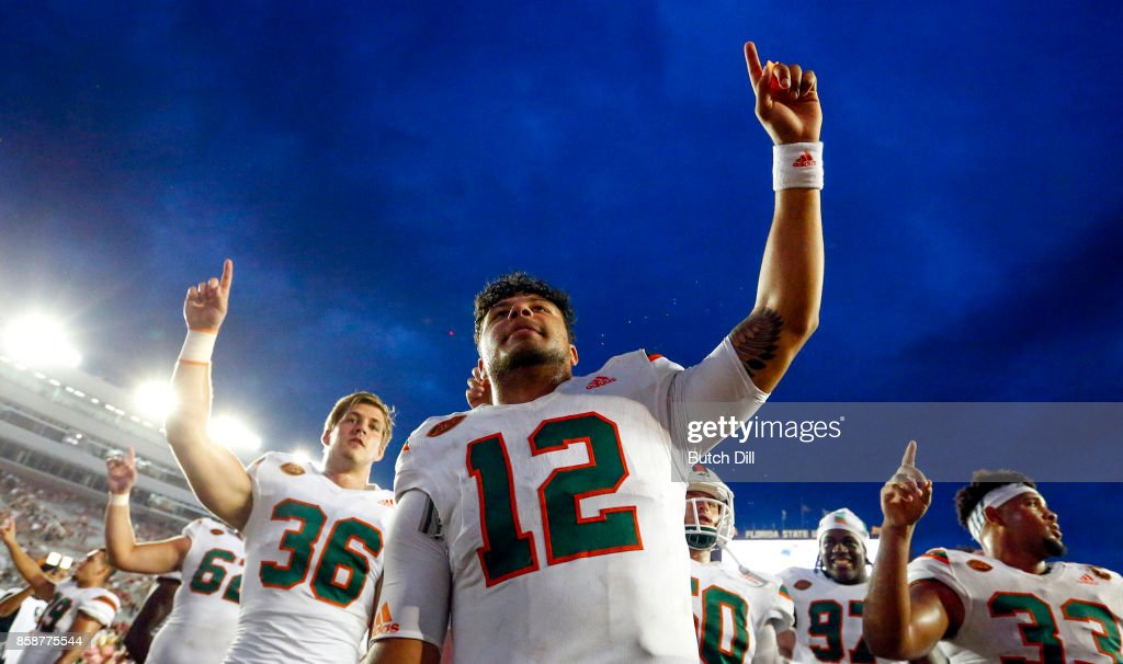 Quarterback Malik Rosier #12 of the Miami Hurricanes celebrates with teammates after they defeated the Florida State Seminoles 24-20 during the second half of an NCAA football game at Doak S. Campbell Stadium on October 7, 2017 in Tallahassee, Florida.