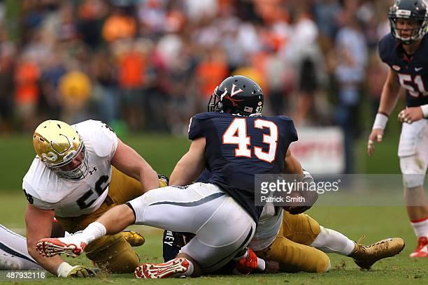 Quarterback Malik Zaire of the Notre Dame Fighting Irish rushes against the Virginia Cavaliers in the third quarter at Scott Stadium on September 12...