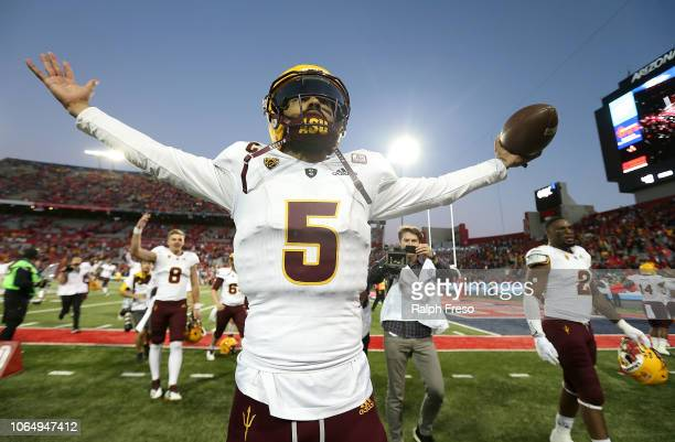 Quarterback Manny Wilkins of the Arizona State Sun Devils celebrates in front of the ASU fans following a 4140 victory against the Arizona Wildcats...