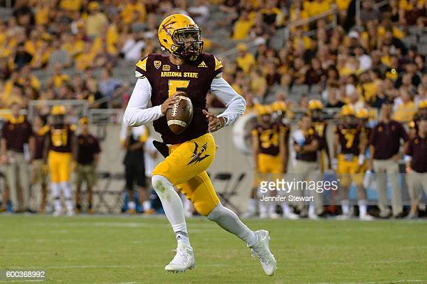Quarterback Manny Wilkins of the Arizona State Sun Devils looks to make a pass during the game against the Northern Arizona Lumberjacks at Sun Devil...
