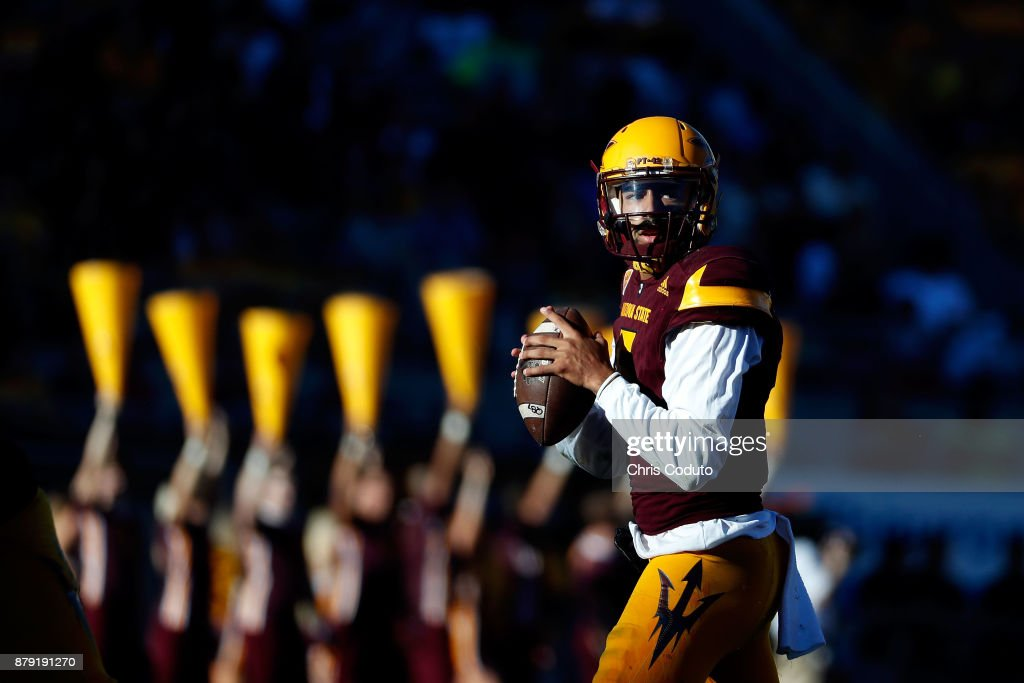 Quarterback Manny Wilkins #5 of the Arizona State Sun Devils looks to pass during the first half of the college football game against the Arizona Wildcats at Sun Devil Stadium on November 25, 2017 in Tempe, Arizona.