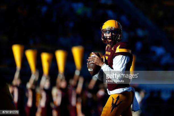 Quarterback Manny Wilkins of the Arizona State Sun Devils looks to pass during the first half of the college football game against the Arizona...