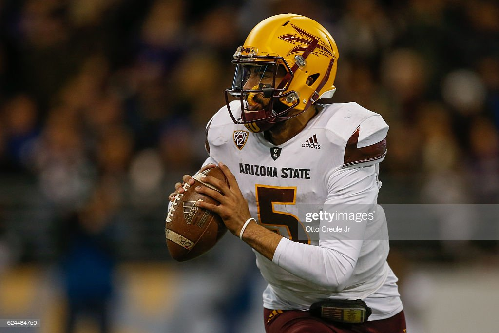 Quarterback Manny Wilkins #5 of the Arizona State Sun Devils rolls out to pass against the Washington Huskies on November 19, 2016 at Husky Stadium in Seattle, Washington. The Huskies defeated the Sun Devils 44-18.