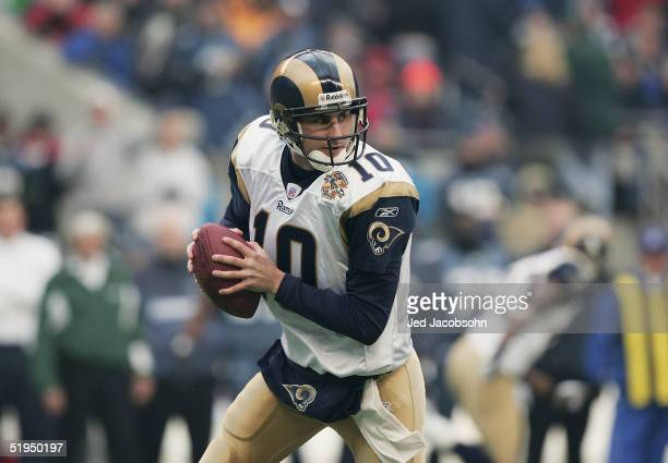 Quarterback Marc Bulger of the St Louis Rams drops back to pass against the Seattle Seahawks in the NFC wildcard game at Qwest Field on January 8...