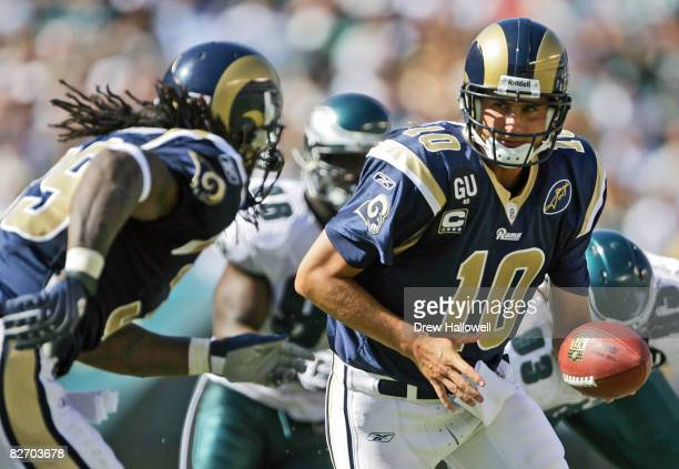 Quarterback Marc Bulger of the St Louis Rams hands the ball off to teammate running back Steven Jackson during the game against the Philadelphia...
