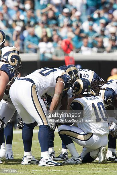 Quarterback Marc Bulger of the St Louis Rams in the huddle during a NFL game against the Jacksonville Jaguars at Jacksonville Municipal Stadium on...