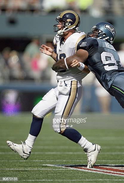 Quarterback Marc Bulger of the St Louis Rams is sacked by Cory Redding of the Seattle Seahawks on September 13 2009 at Qwest Field in Seattle...