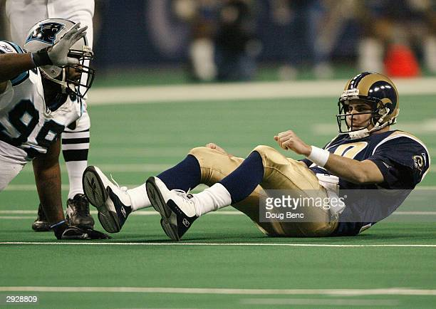 Quarterback Marc Bulger of the St Louis Rams lays on the field next to defensive tackle Brentson Buckner of the Carolina Panthers during the NFC...