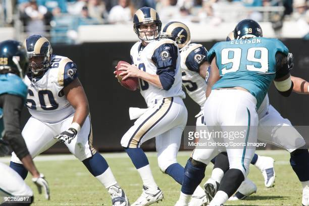 Quarterback Marc Bulger of the St Louis Rams looks for a receiver during a NFL game against the Jacksonville Jaguars at Jacksonville Municipal...