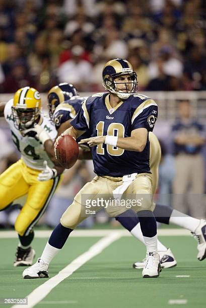 Quarterback Marc Bulger of the St Louis Rams looks for an open man during the game against the Green Bay Packers at the Edward Jones Dome on October...