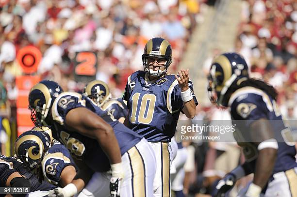 Quarterback Marc Bulger of the St Louis Rams motions to runningback Stephen Jackson during a game on October 12 2008 against the Washington Redskins...