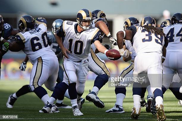 Quarterback Marc Bulger of the St Louis Rams moves to hand off the ball during the game against the Seattle Seahawks on September 13 2009 at Qwest...