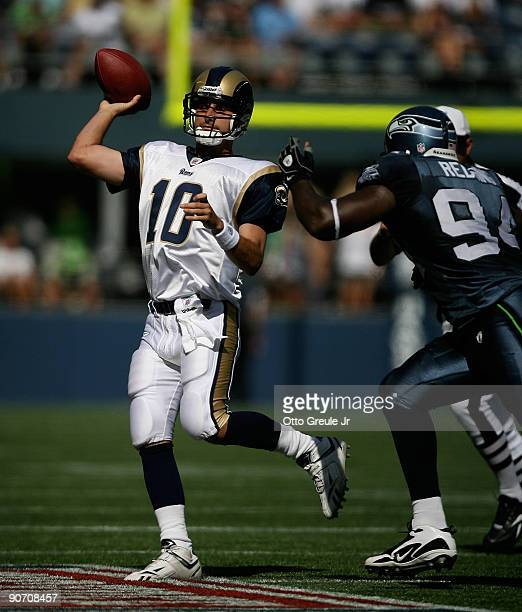 Quarterback Marc Bulger of the St Louis Rams passes against Cory Redding of the Seattle Seahawks on September 13 2009 at Qwest Field in Seattle...