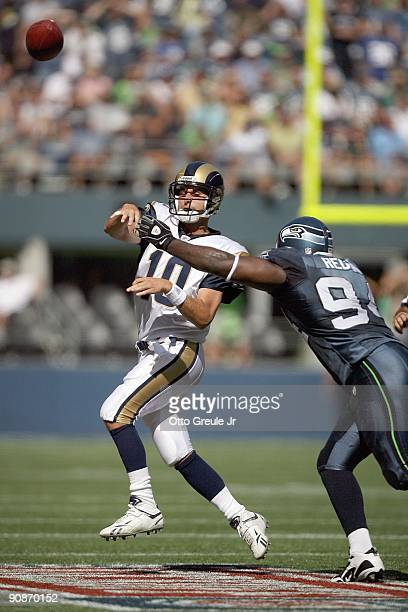Quarterback Marc Bulger of the St Louis Rams passes the ball against Cory Redding of the Seattle Seahawks on September 13 2009 at Qwest Field in...