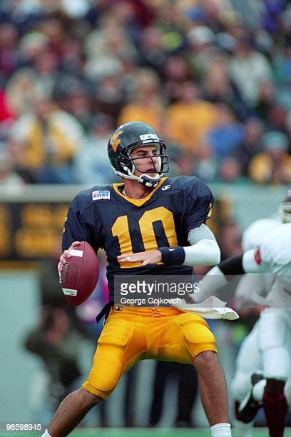 Quarterback Marc Bulger of the West Virginia University Mountaineers passes against the Virginia Tech Hokies during a Big East college football game...