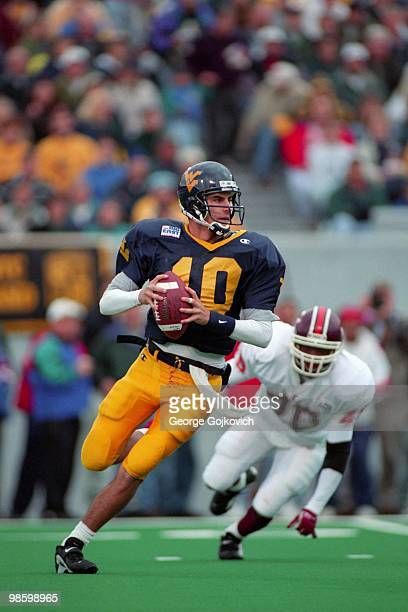 Quarterback Marc Bulger of the West Virginia University Mountaineers looks to pass against the Virginia Tech Hokies during a Big East college...